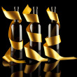 Gold ribbons around bottles — Stockfoto