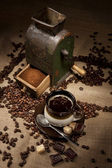 Old coffee mill and cup of coffee with chocolate — Stock Photo
