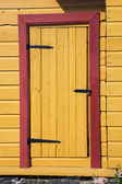 Old yellow wooden door — Stock Photo