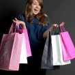 Girl with shopping on the phone — Stock Photo