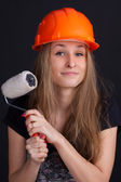 Girl in a helmet with a roller in his hand — Stock Photo