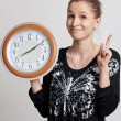 Stock Photo: Beautiful girl with big clock in his hands