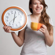 Stock Photo: Portrait of girl with cup and clock
