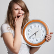 Sleeping girl with a big clock in his hands — Stock Photo #5221102