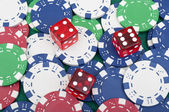 Many poker chips and dice — Foto Stock