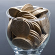 Stock Photo: Coins in glass