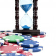 Stock Photo: Hourglass and poker chips
