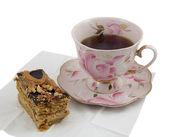 Starožitný tea cup a kouskem medového koláče — Stock fotografie
