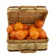 Juicy tangerines in the wicker box over white — Stock Photo #5237311