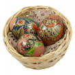 Three Easter eggs in wicker basket over white — Stock Photo #5237352