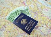 Passport with money over map — Stock Photo