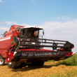 Stock Photo: Combine in a field