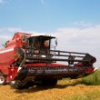 Combine in a field — Stock Photo