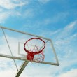 Outdoor basketball hoop over blue sky — Stock Photo #5268351