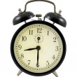Retro alarm clock showing 8 hours and 30 minutes — Zdjęcie stockowe #5271450
