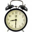 Stock Photo: Retro alarm clock showing 8 hours and 30 minutes