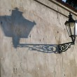 Wall with an old lantern — Stock Photo #5203468