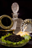 Track with a dish of caviar and a decanter of vodka — Stock Photo