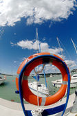 Pier with several sports yachts and a lifeline — Stock Photo