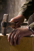 Bricklayer builds the brick wall — Stock Photo