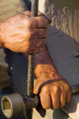 The hands of men working with a lever — Stock Photo