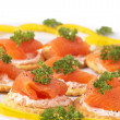 Smoked salmon and cream cheese on crackers — Stock Photo