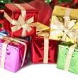 Stack of colorful Christmas gift boxes - Stock Photo