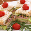 Tasty sandwiches on wholewheat bread - Stock Photo