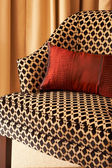 Colorful cushions on the chair — Stock Photo