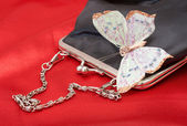 Black purse with butterfly on Valentines — Stock Photo