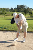 Golfer in the sand bunker — Stock Photo