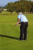 Golfer op de groene — Stockfoto