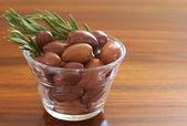 Single jar of black kalamata olives and rosemary — Stock Photo
