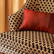 图库照片: Colorful cushions on chair