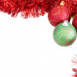 Three Christmas baubles with red tinsel — Stock Photo