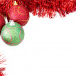 Three Christmas baubles with red tinsel — Стоковая фотография