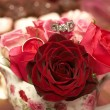 Stock Photo: Bouquet of roses with wedding rings