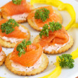 Smoked salmon and cream cheese on crackers — Stock Photo #5161603