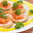 Smoked salmon and cream cheese on crackers — Stock Photo #5161860