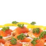 Smoked salmon and cream cheese on crackers — Stock Photo #5162115