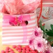 Stock Photo: Two gift bags with pink candy around