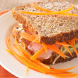 Stock Photo: Tasty beef sandwich on wholewheat bread