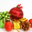 Red Christmas baubles and other decorations — Stock Photo