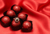 Valentines chocolate candy with a ring — Stock Photo