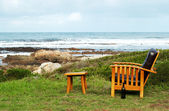 Wooden chair by the ocean — Stock Photo