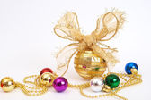 Gold Christmas baubles — Stock Photo