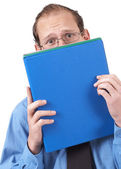 Businessman hiding behind the folder — Stock Photo