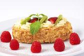 Fruit boat cake with raspberries — Stock Photo