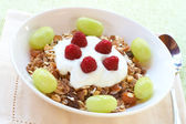 Healthy breakfast with muesli, yoghurt and berries — Stock Photo