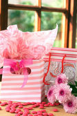 Two gift bags with pink candy around — Stock Photo